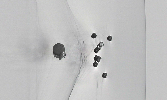 Schlieren Streak Image of Shotgun Pellets in Flight